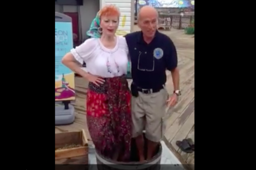 "Seaside Heights Mayor Anthony Vaz stomps grapes with ""Lucy."""