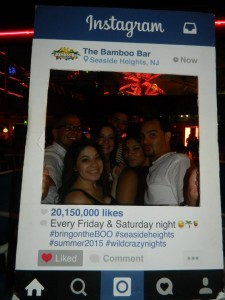 Clubgoers at Bamboo pose at the bar's Instagram cutout. (Credit: Bamboo)
