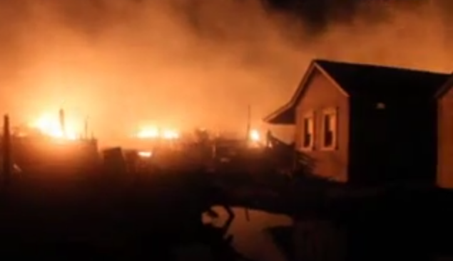 A fire at the Camp Osborn neighborhood during Superstorm Sandy. (Robert Raia/YouTube)