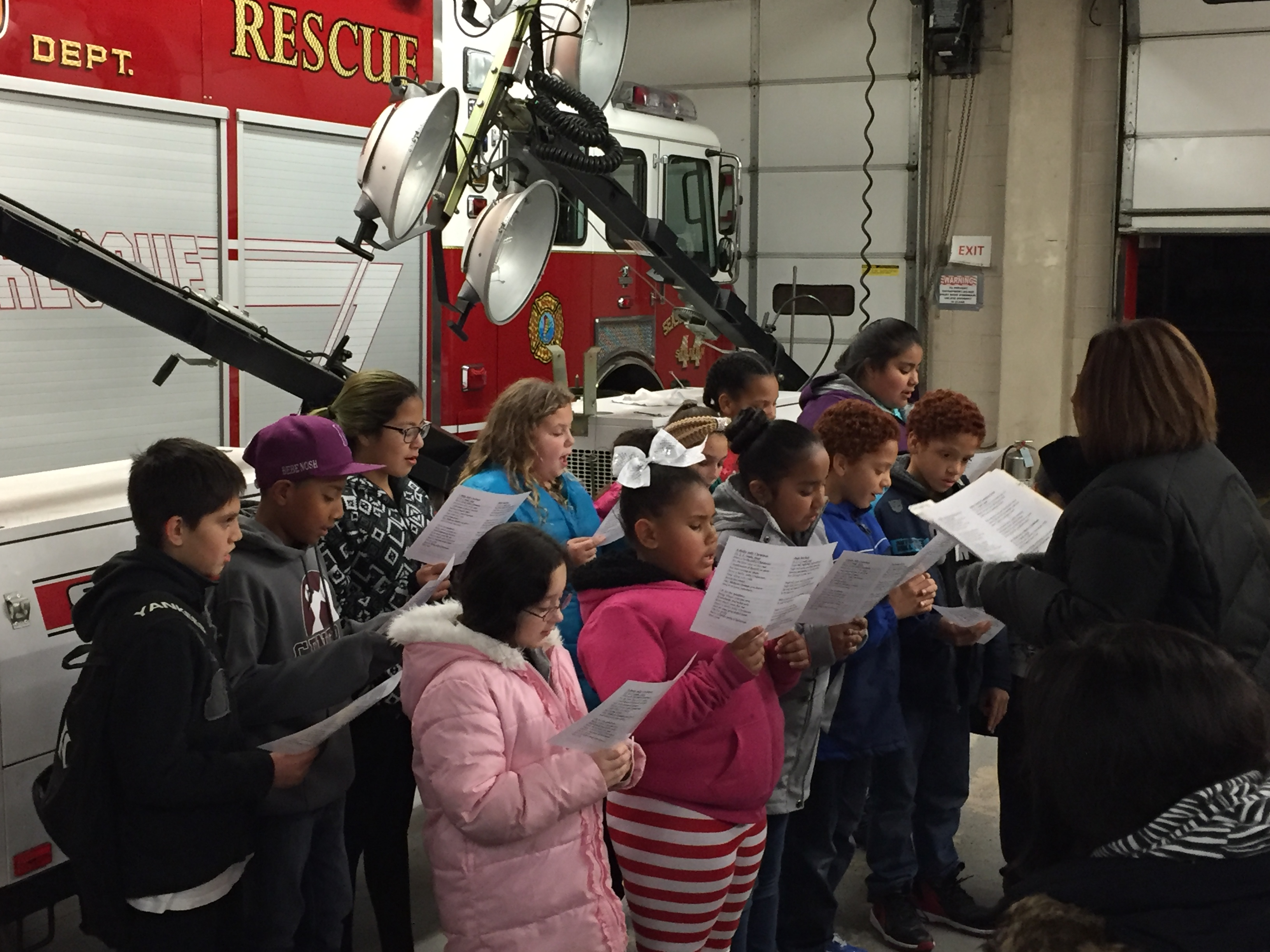 Children from Seaside Heights perform Christmas carols at the borough's annual tree lighting, Dec. 4, 2015. (Photo: Daniel Nee)