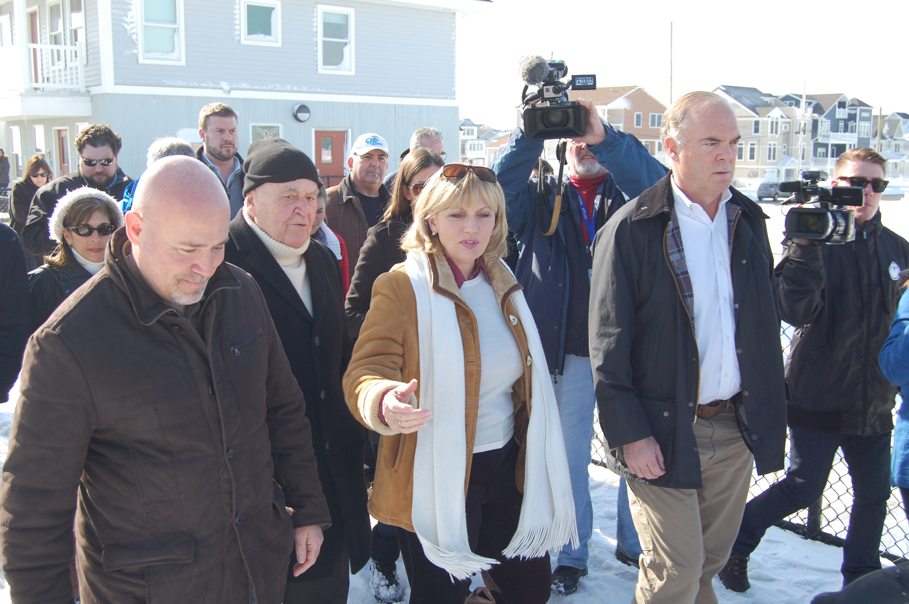 U.S. Rep. Tom MacArthur, Toms River Mayor Thomas Kelaher, Lt. Gov. Kim Guadagno and DEP Commissioner Bob Martin tour the Ortley Beach boardwalk, Jan. 25, 2016. (Photo: Daniel Nee)