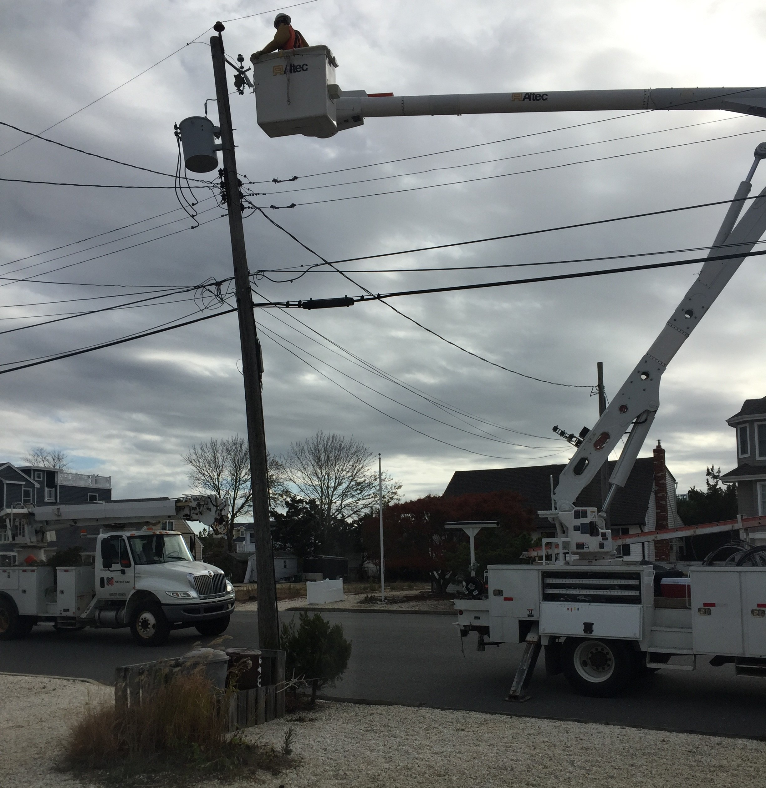 A new utility pole being installed in an Ocean County barrier island community. (Photo: Daniel Nee)