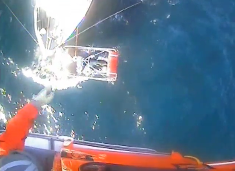An injured fisherman is hoisted aboard a Coast Guard helicopter off Barnegat Inlet. (Photo: USCG)