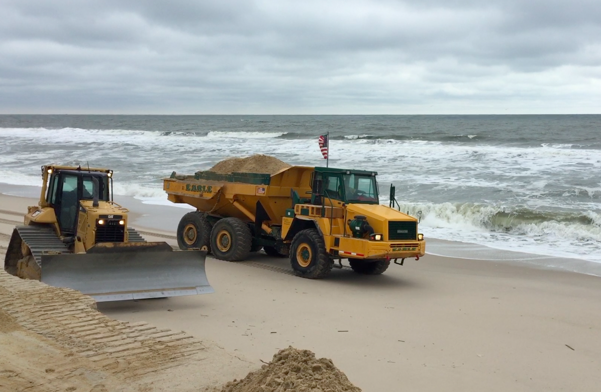 Crews from Earle Asphalt build up makeshift berms in Toms River's portion of Normandy Beach. (Photo: Daniel Nee)