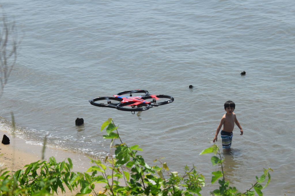 A drone in use near a beach. (Photo: Tony Alter/Flickr)