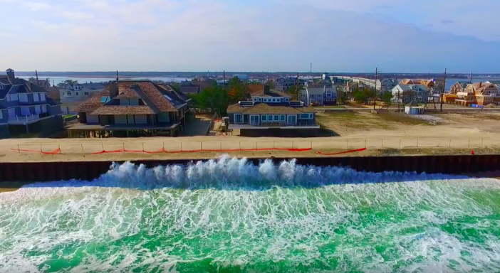 Waves crash against a sea wall in Mantoloking, NJ. (Photo: Mantoloking Aerial Photography)