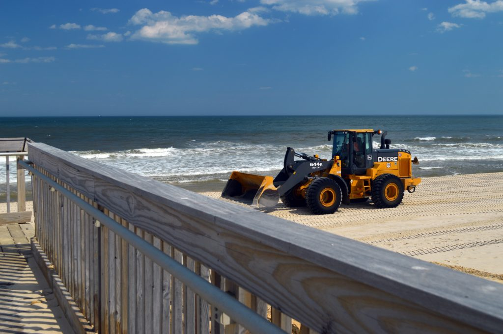 A tractor moves sand on the Ortley Beach oceanfront, April 26, 2016. (Photo: Daniel Nee)