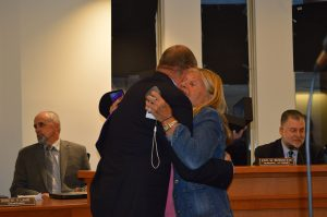 Christopher Parlow receives a hug from Lavallette Council President Anita Zalom at his final meeting with the borough. (Photo: Daniel Nee)