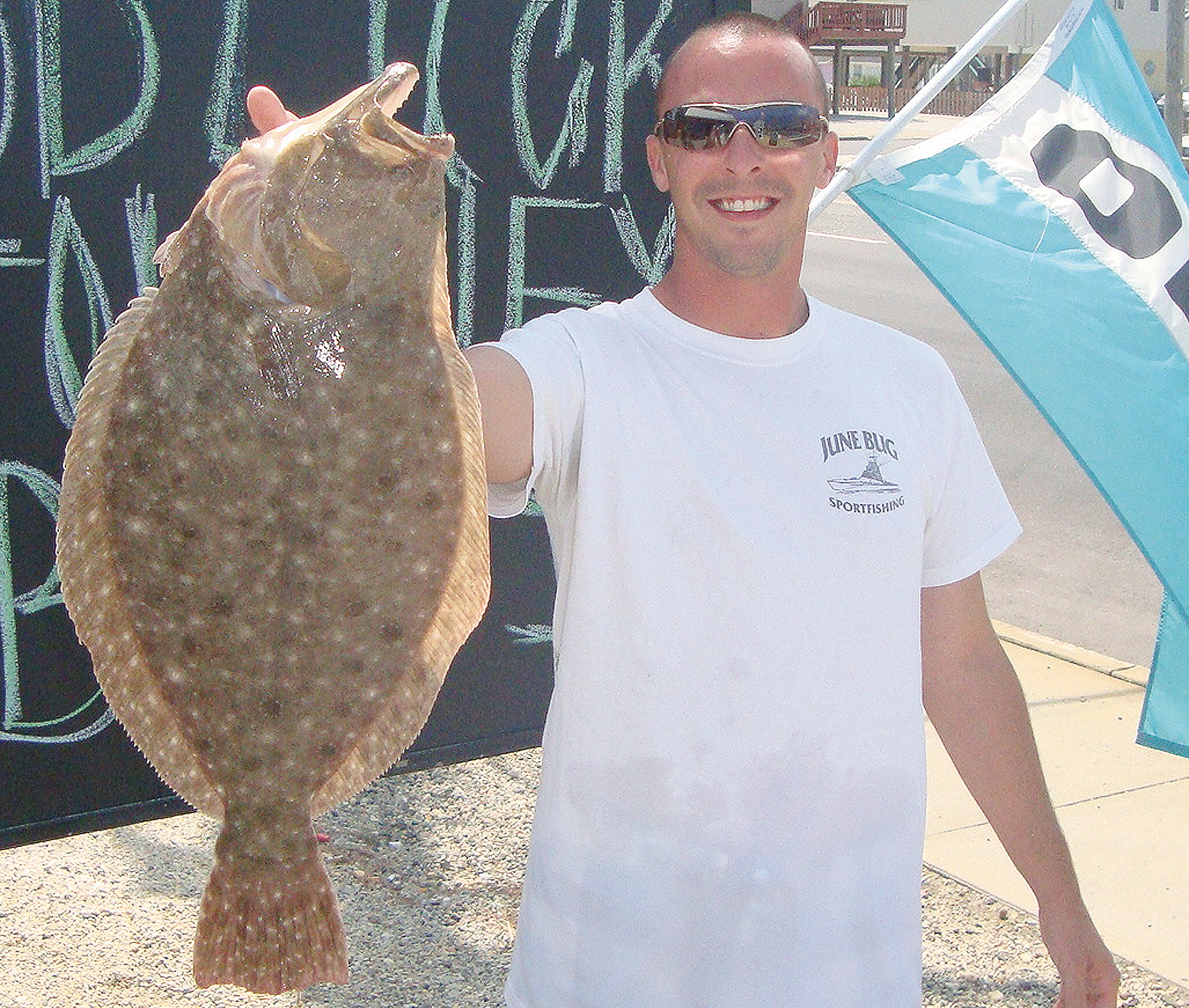 An angler shows off his fluke caught in Barnegat Bay. (Photo: Jersey Shore Fishing Magazine)