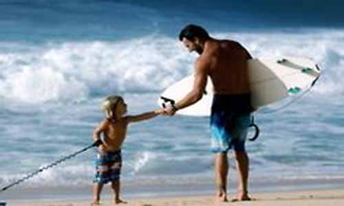 Father and son at the beach. (File Photo)