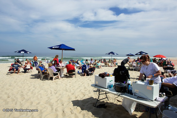 Attendees enjoy food on the beach during the 2015 paws4vets fundraiser. (Credit: Tim Sharkey)