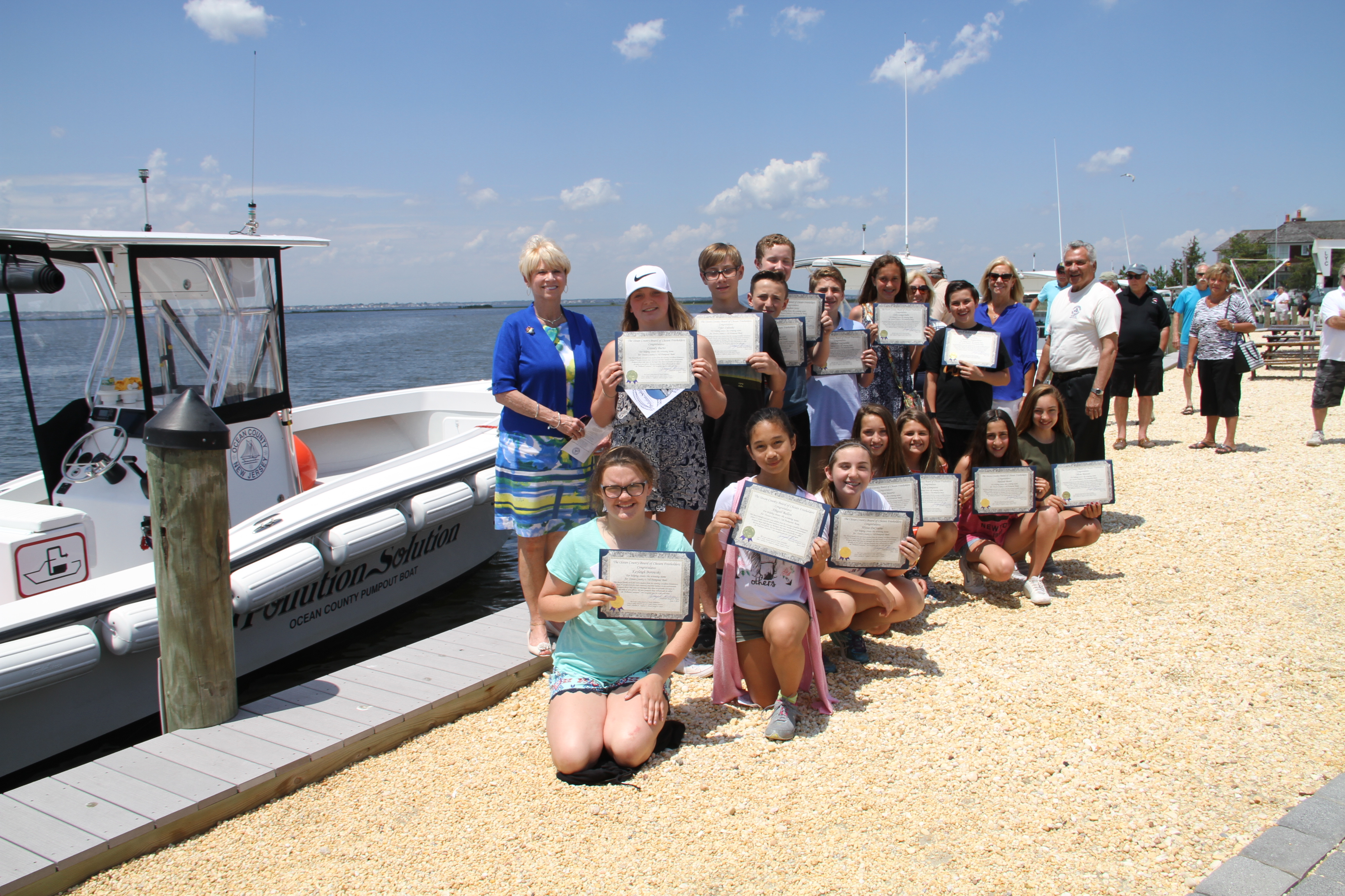 Seventh graders at Lavallette Elementary School, next to the pumpout boat they named. (Photo: Ocean County)