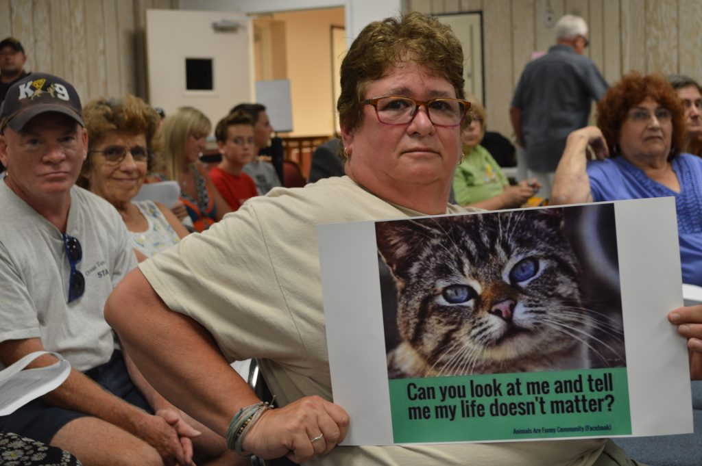 A protester at the Seaside Heights council meeting, July 20, 2016. (Photo: Daniel Nee)