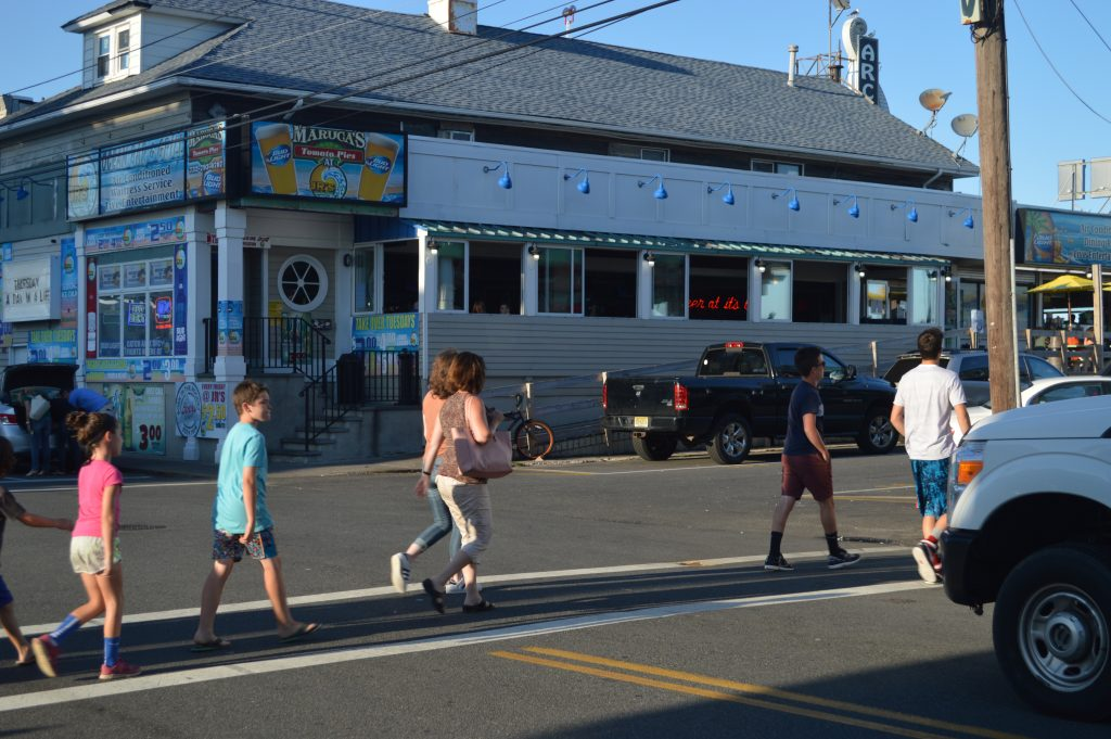 Pedestrians cross Ocean Terrace in Seaside Heights. (Photo: Daniel Nee)
