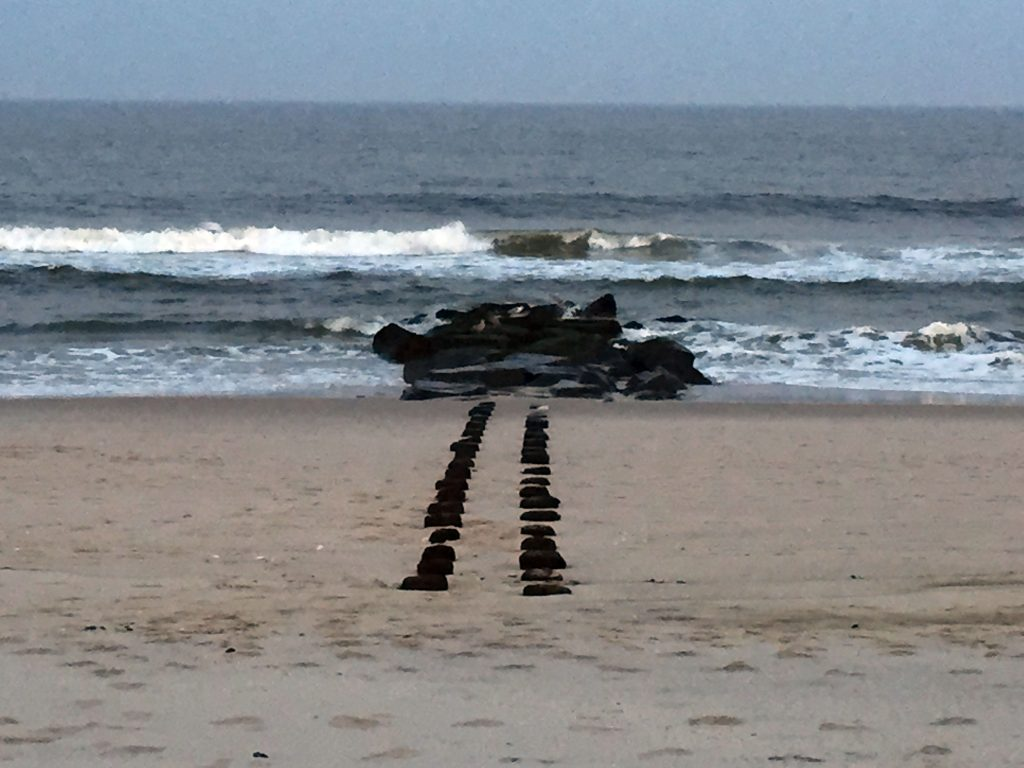 An exposed jetty illustrates the small amount of sand east of the dune line on Elizabeth Avenue in Lavallette. (Photo: Daniel Nee)
