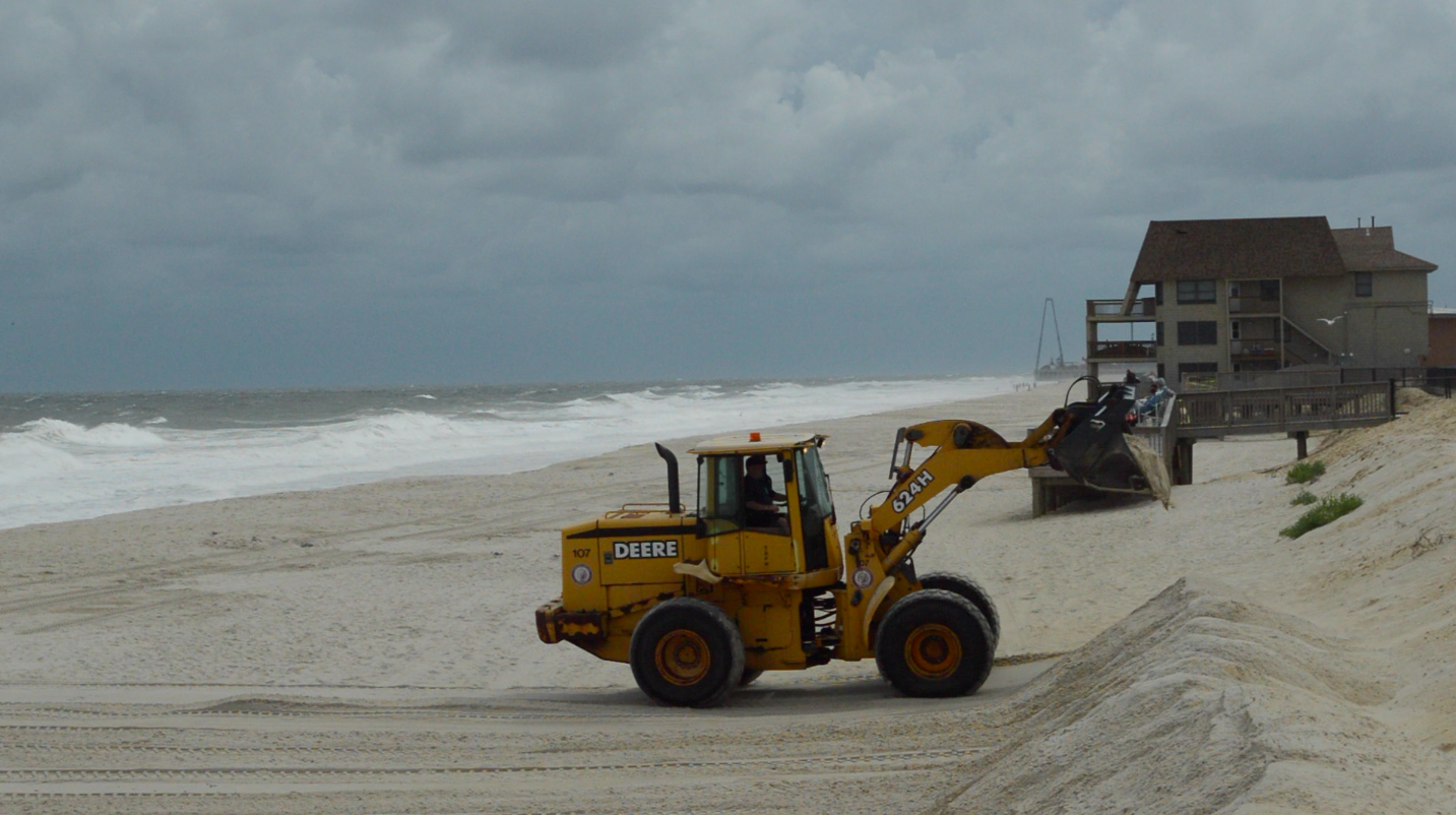 Front loaders create a secondary dune berm in anticipation of Hermine, Sept. 3, 2016. (Photo: Daniel Nee)