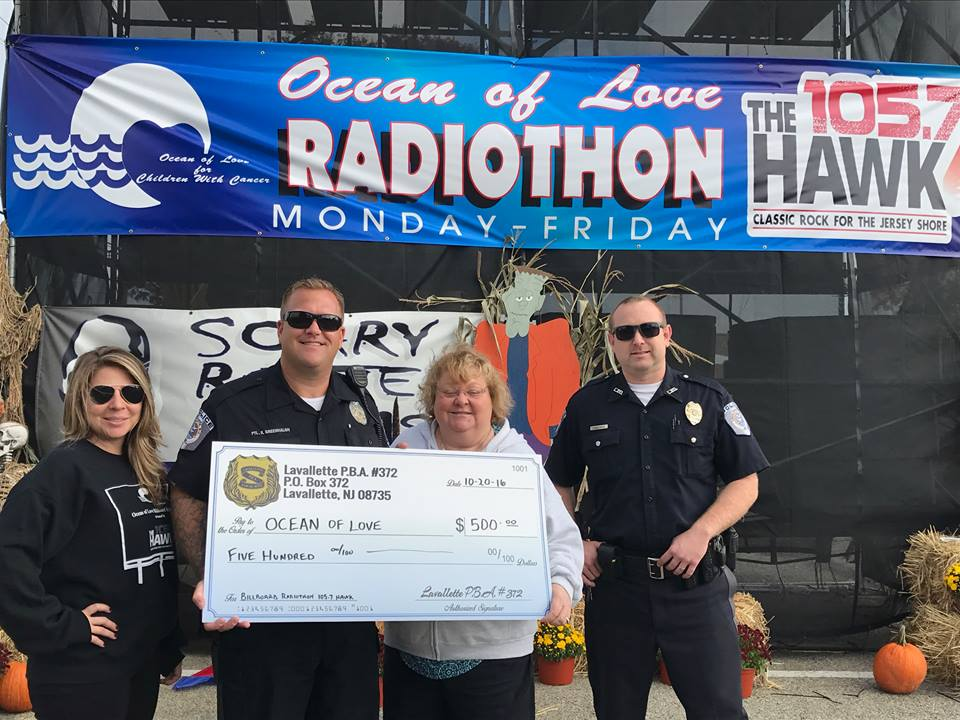 Lavallette PBA members drop off a check at the 105.7 The Hawk billboard to support Oceans of Love. (Photo: Lavallette PBA)