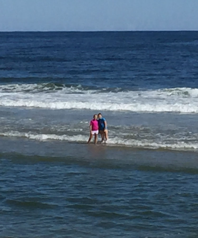 The girls on a sandbar, minutes before they were pulled out to sea in a rip current. (Family Photo)
