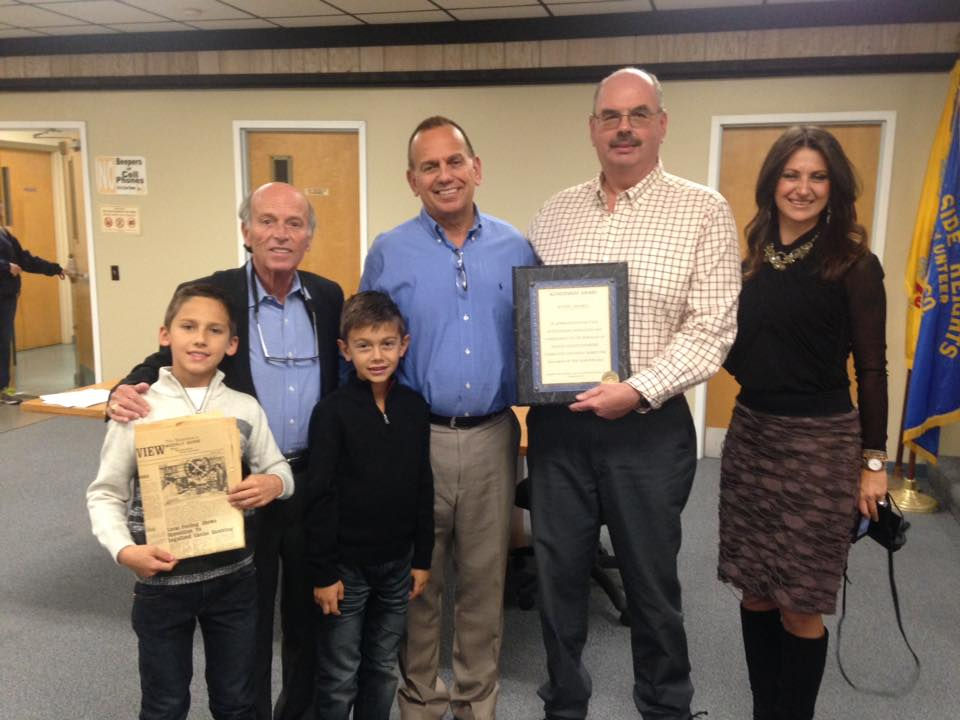 Mayor Anthony Vaz and Councilman Richard Tompkins present a resolution to Wayne Cimorelli and his family. (Photo: Daniel Nee)