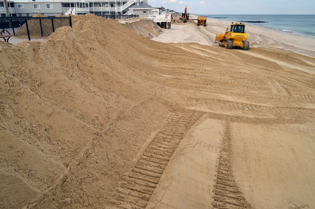 Work continues to rebuild protective berms in Ortley Beach following a nor'easter, Feb. 2, 2017. (Photo: Daniel Nee)
