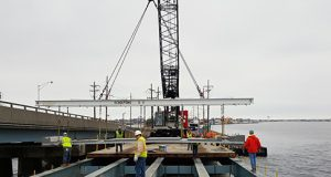 Workers placing a new deck on the Mathis bridge that carries Route 37 over Barnegat Bay. (Photo: NJDOT)