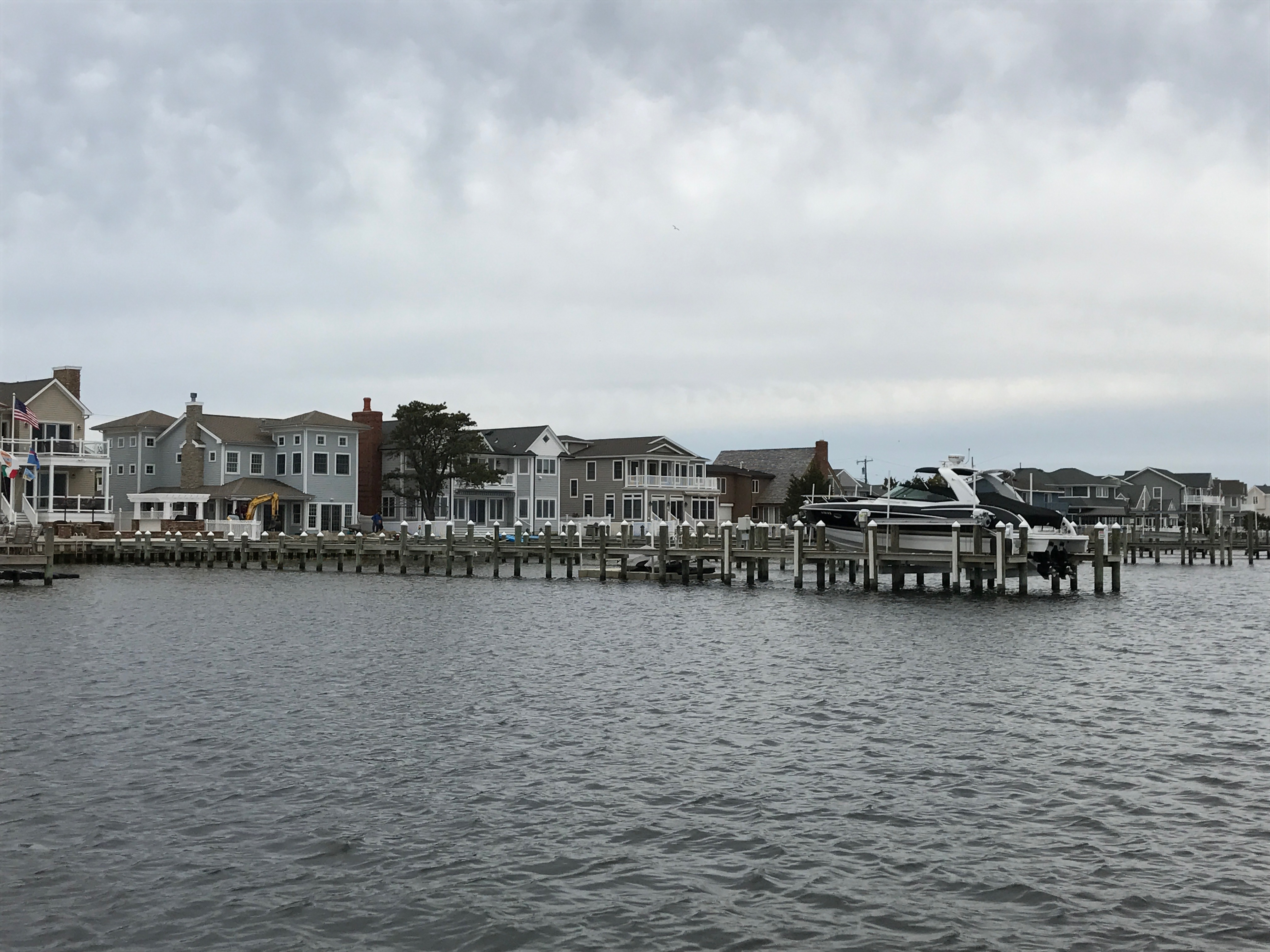 A boat dock extends out into Barnegat Bay. (Photo: Daniel Nee)