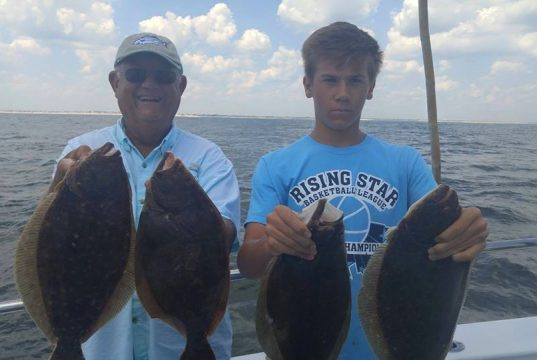 Grandpa Denny and Grandson Ryan on board the Cock Robin party boat out of Point Pleasant Beach this week. The pair nabbed four keeper fluke! (Photo: Cock Robin Crew)