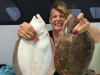A happy customer with two keeper fluke on board the Gambler party boat. (Photo: Gambler Crew)