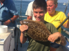 A happy young fluke angler on board the Gambler. (Photo: Gambler Crew)