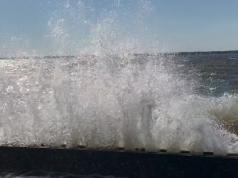 A wave crashes over a bulkhead in Seaside Park, N.J., Oct. 30, 2017. (Photo: Daniel Nee)