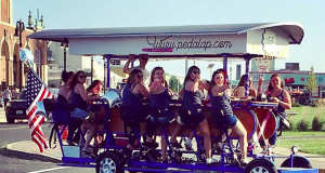 A group on board the Asbury Pedacycle attraction in Asbury Park. (Credit: Asbury Pedacycle/Instagram)