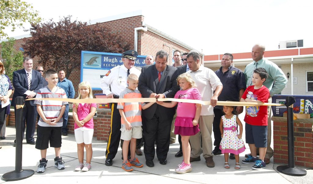 Governor Chris Christie helps cut the ribbon at Hugh J. Boyd, Jr. Elementary School for their reopening after being damaged by Hurricane Sandy in Seaside Heights, N.J. on Thursday, Sept. 5, 2013. (Governor's Office/Tim Larsen)