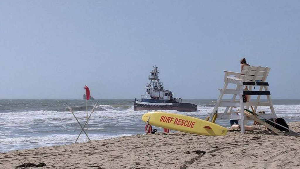 A tug boat stuck near the shore in Lavallette, July 24, 2018. (Credit: Lavallette Beach Patrol)