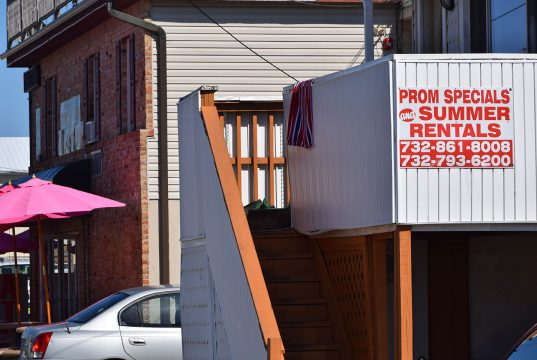 A sign advertising prom and summer rentals in Seaside Heights. (Photo: Daniel Nee)