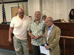 Councilmen Rich Tompkins and Guy Mazzanti receiving honors at the Seaside Heights municipal complex. (Photo: Daniel Nee)
