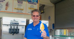Greg Kohr serves a cone of frozen custard outside one of his three stores in Seaside Heights, N.J., May 2019. (Photo: Daniel Nee)