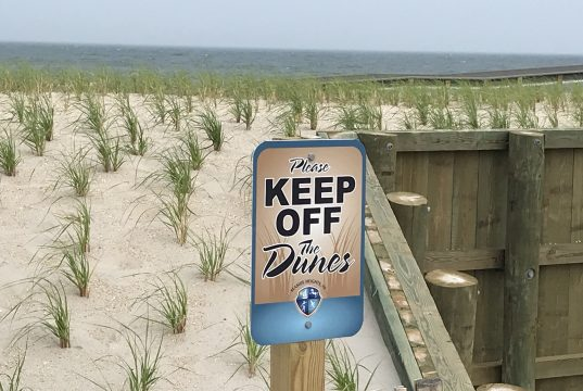 A 'Keep off the Dunes' sign in Seaside Heights, N.J., June 2019. (Photo: Daniel Nee)