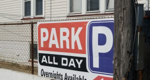 Signs at a private parking lot in Seaside Heights, N.J., July 2019. (Photo: Daniel Nee)