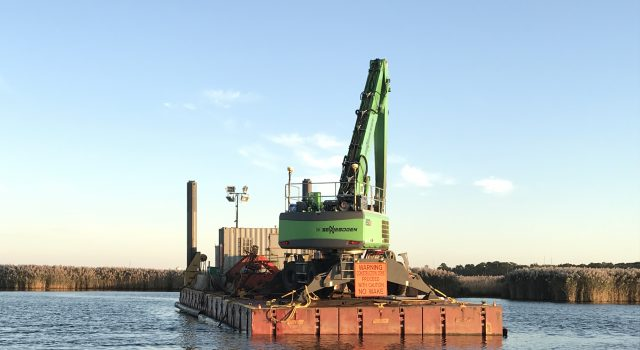 A dredge barge rests in the narrows of the Metedeconk River on Oct. 15, 2019. (Photo: Daniel Nee)
