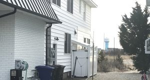 Trash and recycling cans beside a house in Lavallette. (Photo: Daniel Nee)