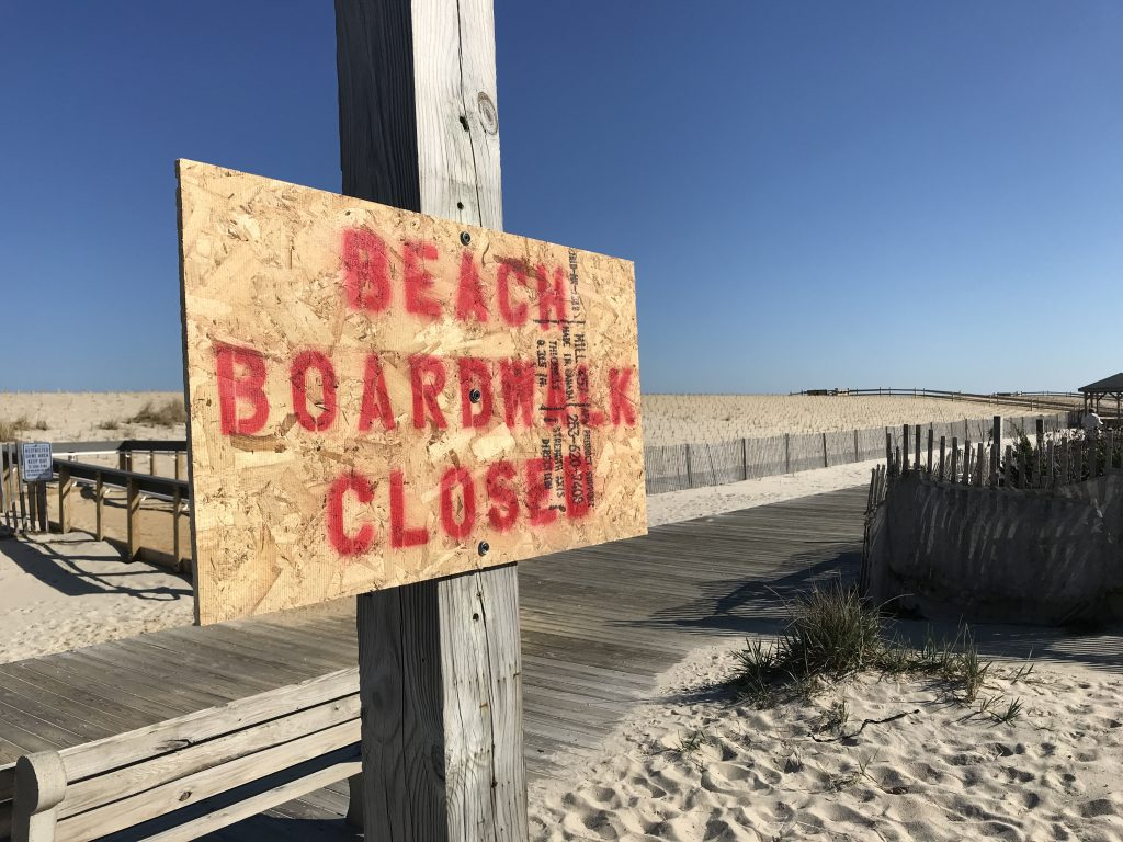 A sign posted at the Lavallette boardwalk entrance on President Avenue, March 26, 2020. (Photo: Daniel Nee)