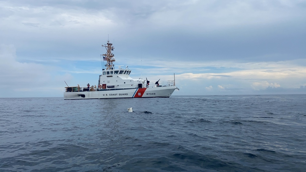 Coast Guard Cutter Shearwater arrives on scene where a sea turtle is entangled in a fishing trap line 11 miles southeast of Cape May, New Jersey, August 13, 2020. The crew sprang into action to rescue the turtle when they spotted sharks beginning to swarm. (U.S. Coast Guard photo by Fireman Jason Breckner)