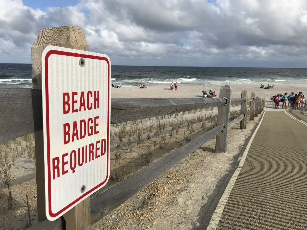 A beach badge sign on the Ortley Beach oceanfront. (Photo: Daniel Nee)