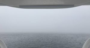 A boat navigates Barnegat Bay in dense fog. (Photo: Daniel Nee)