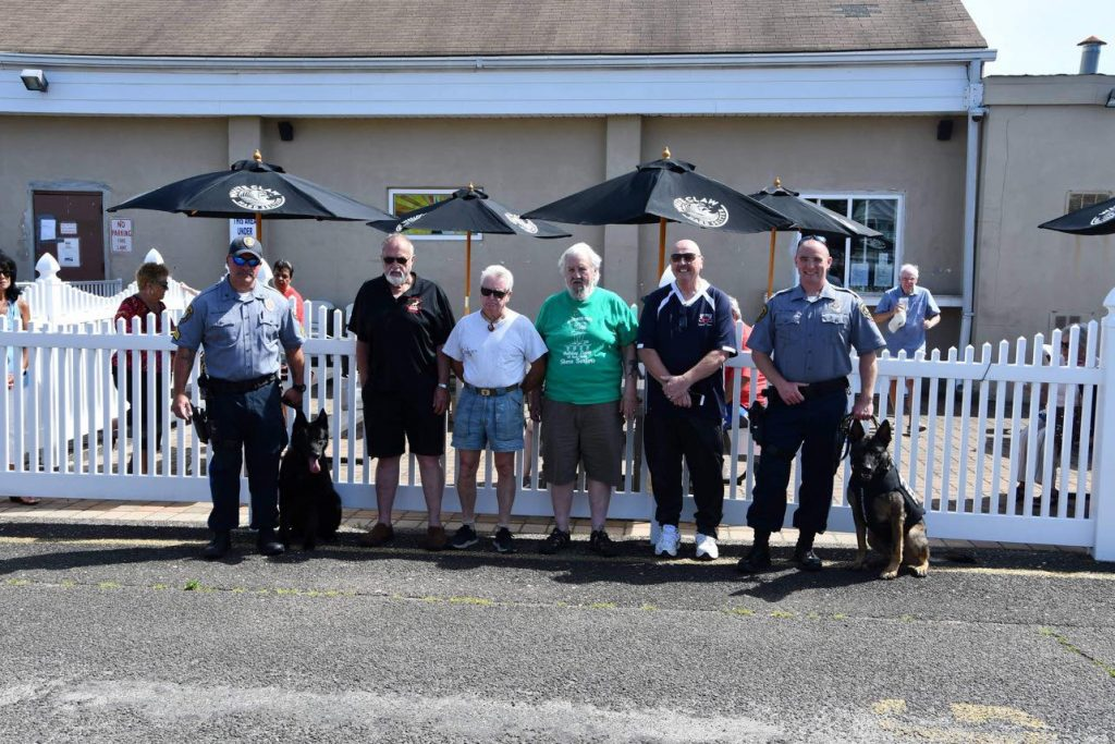 The Toms River Police Department K9 handlers and their partners perform a demonstration at the Ortley Beach Moose Lodge, July 2021. (Credit: TRPD)
