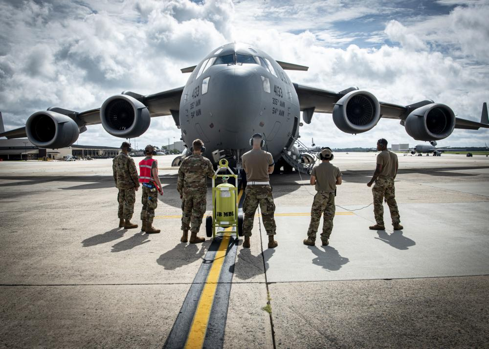 Airmen assigned to the 305th Maintenance Group prepare to launch a C-17 Globemaster III assigned to the 305th Air Mobility Wing at Joint Base McGuire-Dix-Lakehurst, N.J., Aug. 18, 2021. The 305th AMW is responsible for delivering Rapid Global Mobility to the U.S. and its allies throughout the world. The unit's C-17 fleet was relocated to support operations in Kabul, Afghanistan. (U.S. Air Force photo by Airman 1st Class Azaria E. Foster)