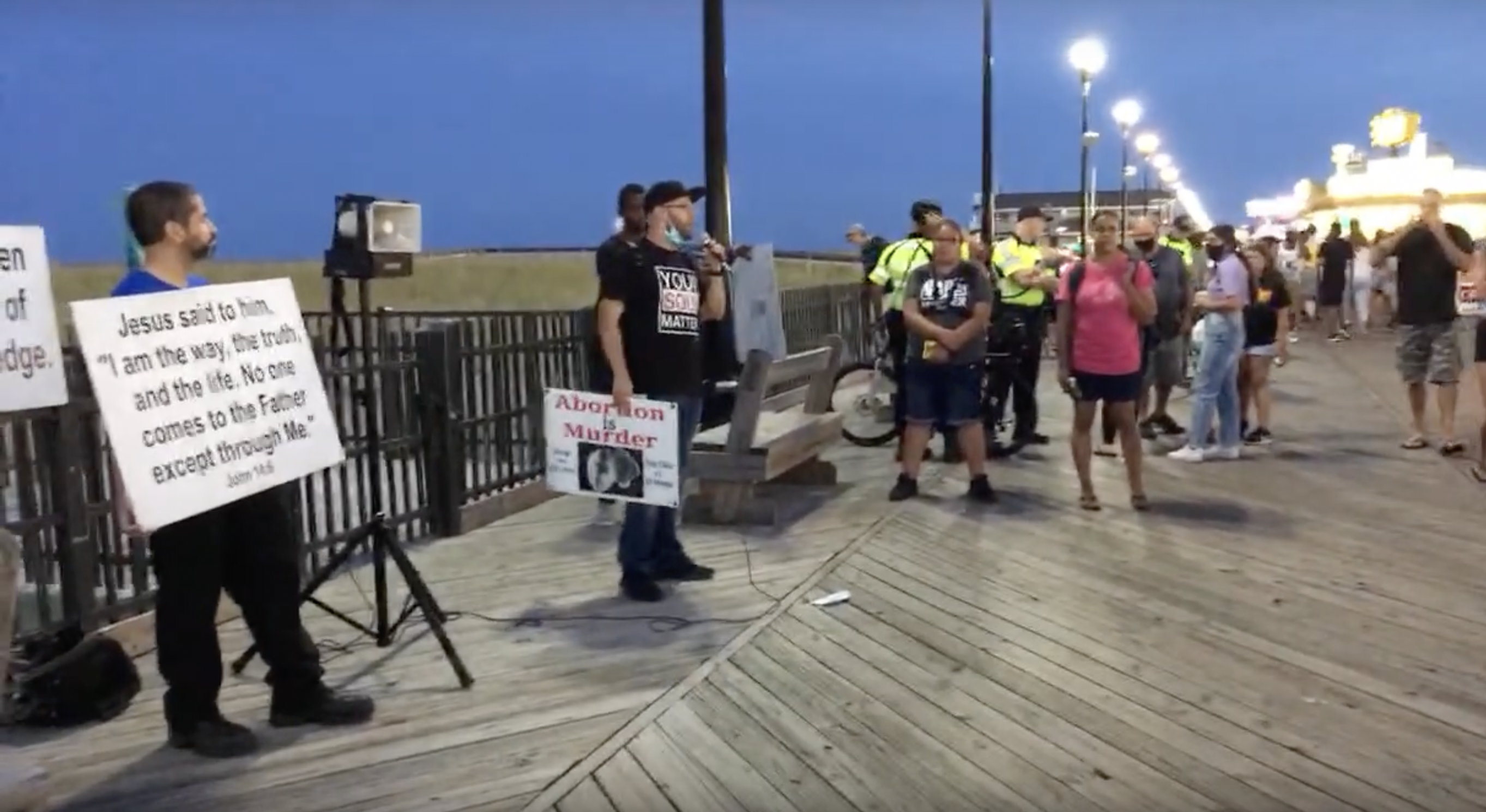 A group of religious activists demonstrate on the boardwalk in Seaside Heights, N.J. (Credit: Time to Change/YouTube)
