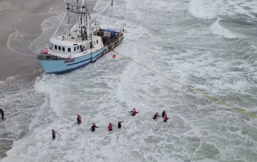 The Bear, a 68-foot scallop boat, imperiled at Island Beach State Park. (Credit: YouTube/SuazOnn)
